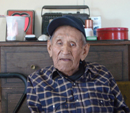 Photo of John Sandoval in his home