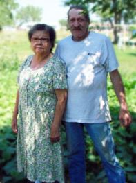 Paul and Jackie posing in front of their Project Grow garden