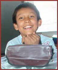 Native American student happy with his school supplies and backpack