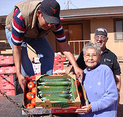 Native American Elder receiving fresh produce.
