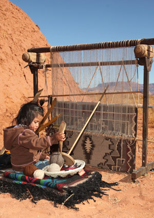 Girl weaving Navajo rug