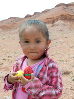 Native American child enjoying Easter eggs.